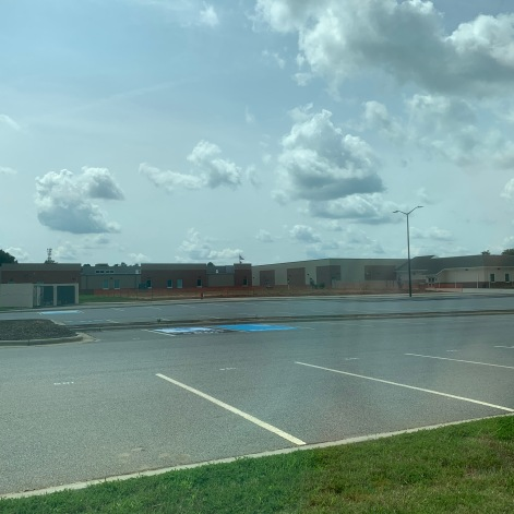 Empty high school parking lot while students are virtual