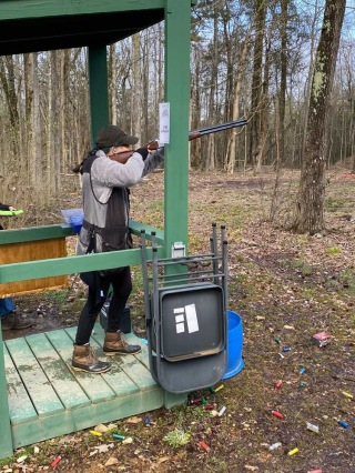 Simcic shooting at practices and competitions.
