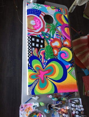 Juliana Peters enjoyed painting corn hole boards