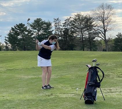 Senior Ally Mattingly takes a swing.