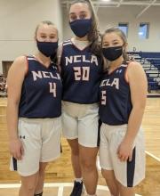 Varsity girls basketball. Mary Dehart, Maura Perkins, and Emily Vroom.