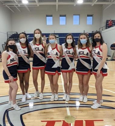 Varsity Cheerleading. Mercy Newnum, Caroline Rice, Amber Matias, Christine Parker, Macey Green, Annie Ellis, and Madison Jennings.