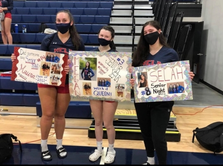 Varsity girls volleyball. Maura Perkins, Megan Queen, and Selah Smith.